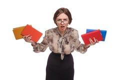 Mujer enojada en vidrios con los libros aislados encendido Fotografía de archivo libre de regalías