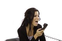 Mujer enojada que grita en teléfono Fotos de archivo libres de regalías
