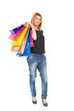 Mujer enrrollada y de moda de las compras Foto de archivo libre de regalías