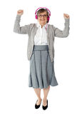 Mujer envejecida alegre que disfruta de música Imágenes de archivo libres de regalías