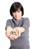 Mujer envejecida con la medicina Foto de archivo