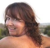 Mujer envejecida media que sonríe Imágenes de archivo libres de regalías
