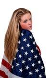 Mujer envuelta en una bandera Fotos de archivo libres de regalías