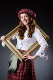 Mujer escocesa con el marco Foto de archivo libre de regalías