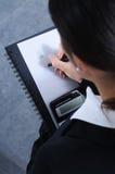 mujer, escribir, calcular Imagen de archivo libre de regalías