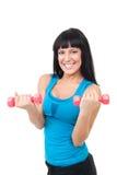Mujer extremadamente feliz con pesas de gimnasia Imágenes de archivo libres de regalías