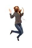 Mujer feliz adolescente que salta en el aire Imagen de archivo