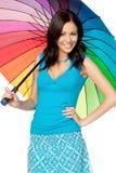 Mujer feliz bajo el paraguas Fotos de archivo