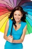 Mujer feliz bajo el paraguas Foto de archivo libre de regalías
