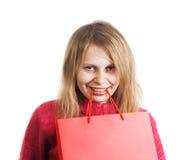Mujer feliz con el bolso de compras Foto de archivo
