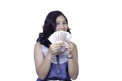 Mujer feliz con el dinero foto de archivo