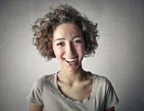 Mujer feliz con el pelo rizado Imagen de archivo libre de regalías