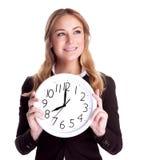 Mujer feliz con el reloj grande Foto de archivo libre de regalías