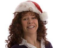 Mujer feliz con el sombrero de la Navidad foto de archivo libre de regalías