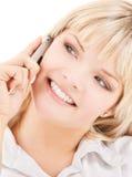Mujer feliz con el teléfono celular foto de archivo libre de regalías