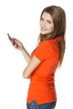 Mujer feliz con el teléfono móvil Foto de archivo libre de regalías
