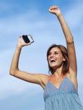 Mujer feliz con el teléfono móvil Imágenes de archivo libres de regalías