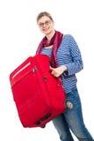 Mujer feliz con equipaje Imagenes de archivo