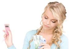Mujer feliz con la calculadora y el dinero Fotografía de archivo libre de regalías