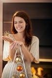 Mujer feliz con la estrella de la Navidad Fotografía de archivo libre de regalías