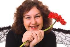 Mujer feliz con la flor Fotos de archivo libres de regalías
