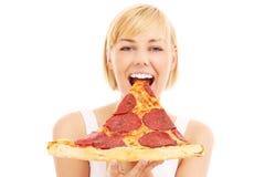 Mujer feliz con la pizza Imagenes de archivo