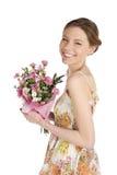 Mujer feliz con las flores Foto de archivo libre de regalías