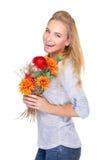Mujer feliz con las flores Imagenes de archivo