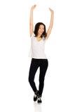 Mujer feliz con las manos para arriba Foto de archivo libre de regalías