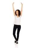 Mujer feliz con las manos para arriba Fotografía de archivo libre de regalías