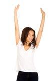 Mujer feliz con las manos para arriba Imagen de archivo libre de regalías
