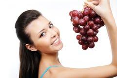Mujer feliz con las uvas Fotos de archivo