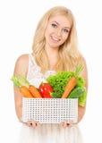 Mujer feliz con las verduras frescas Imagen de archivo