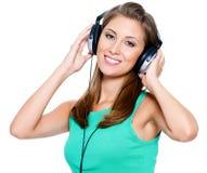 Mujer feliz con los auriculares Fotografía de archivo libre de regalías