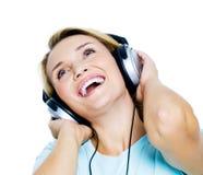 Mujer feliz con los auriculares Imágenes de archivo libres de regalías