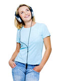 Mujer feliz con los auriculares Fotos de archivo libres de regalías