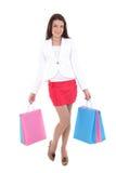Mujer feliz con los bolsos de compras Foto de archivo