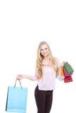 Mujer feliz con los bolsos de compras Fotos de archivo
