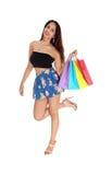 Mujer feliz con los bolsos de compras Fotografía de archivo