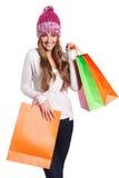 Mujer feliz con los bolsos de compras aislados en blanco Fotografía de archivo libre de regalías