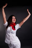 Mujer feliz con los brazos en aire Imagen de archivo