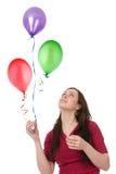 Mujer feliz con los globos Fotos de archivo libres de regalías