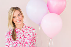 Mujer feliz con los globos del partido Fotografía de archivo libre de regalías