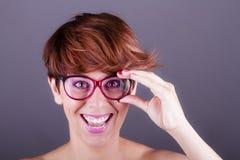Mujer feliz con los vidrios imagen de archivo libre de regalías