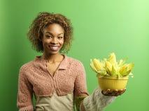 Mujer feliz con maíz Imágenes de archivo libres de regalías