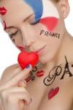 Mujer feliz con maquillaje en el tema de Francia Fotos de archivo libres de regalías