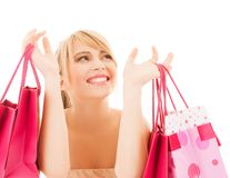 Mujer feliz con muchos panieres Imagen de archivo