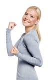 Mujer feliz con sus puños para arriba Imágenes de archivo libres de regalías