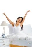 Mujer feliz de la cama Foto de archivo libre de regalías