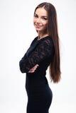 Mujer feliz de la moda en vestido negro Imagen de archivo